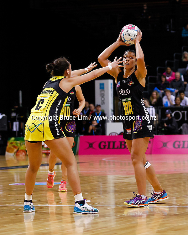 Waikato BOP Magic's Grace Rasmussen looks to pass under pressure from Central Pulse's Elias Shadrock during the ANZ Championship Netball match - Magic v Pulse, played on Monday 25 May 2015 at Claudelands Arena, Hamilton, New Zealand.  Copyright Photo:  Bruce Lim / www.photosport.co.nz