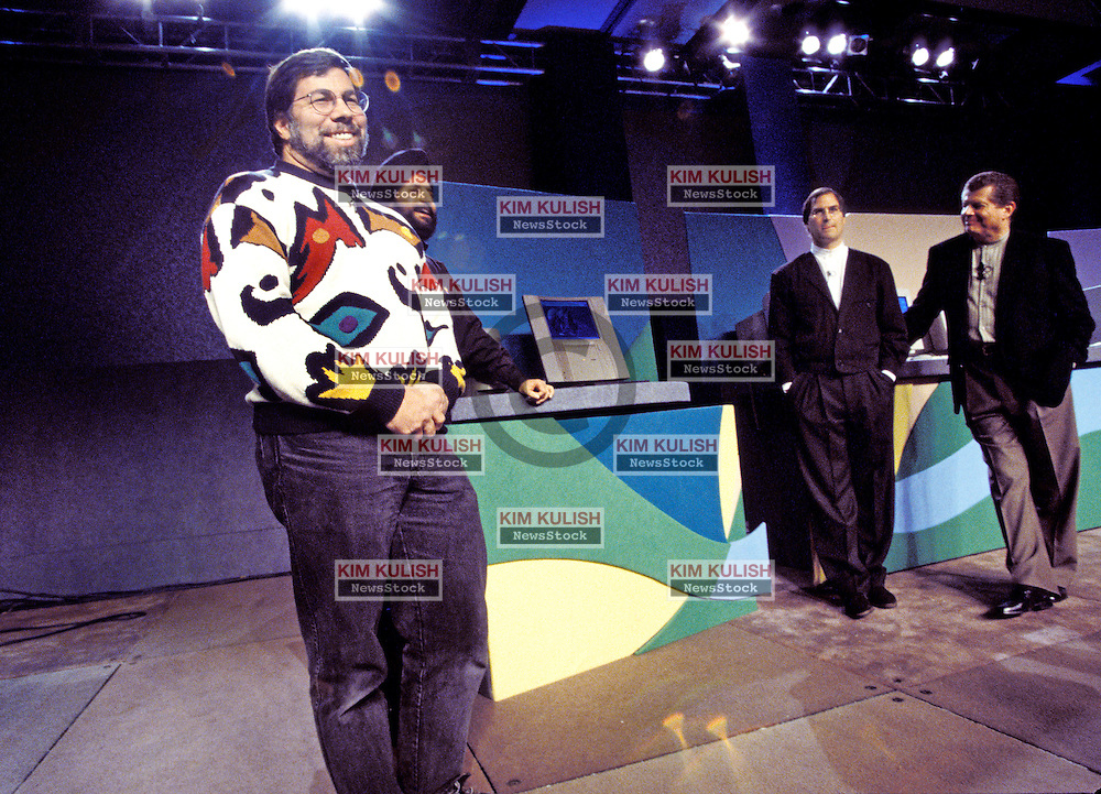 Steve Wozniak, Left with Steve Jobs and Gil Amelio  at  Macworld 1997 in San Francisco, California.