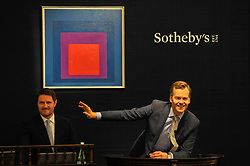 © Licensed to London News Pictures. 05/10/2017. London, UK.  'Homage To The Square: Temperate', 1957, by Josef Albers sold for a hammer price of GBP1,900k (Est. GBP700-1,000k) at the Italian and Contemporary Art evening auction at Sotheby's, New Bond Street, coinciding with the opening of the London's Frieze Art Fair. Photo credit : Stephen Chung/LNP