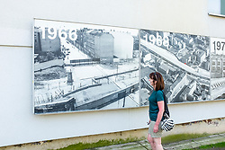 Historic photographs on building at Berlin Wall Memorial on Bernauer Strasse , Berlin, Germany. The Gedenkstätte Berliner Mauer commemorates the division of Berlin by the Berlin Wall and the deaths that occurred there. The monument was created in 1998 by the Federal Republic of Germany and the Federal State of Berlin.