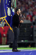 Singer Luke Bryan sings the National Anthem before the New England Patriots Super Bowl LI football game against the Atlanta Falcons on Sunday, Feb. 5, 2017 in Houston. The Patriots won the game 34-28 in overtime. (©Paul Anthony Spinelli)