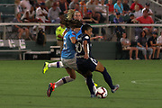 North Carolina Courage midfielder Debiinha (10) and Manchester City midfielder Jill Scott (8) fight for possession of the ball during an International Champions Cup women's soccer game, Thurday, Aug. 15, 2019, in Cary, NC. The North Carolina Courage defeated Manchester City Women 2-1.  (Brian Villanueva/Image of Sport)