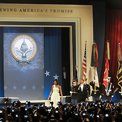 President Barack Obama and First Lady Michelle Obama speak during the Home State Ball on the night of the inauguration.