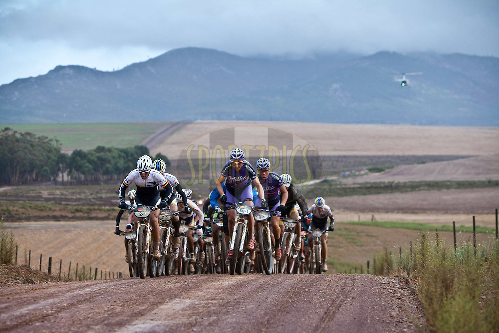 leaders leave Caledon during stage 5 of the 2012 Absa Cape Epic Mountain Bike stage race from the Overberg Primary & High School in Caledon to Oak Valley Wine Estate in the Elgin Valley, South Africa on the 30 March 2012..Photo by Karin Schermbrucker/Cape Epic/SPORTZPICS