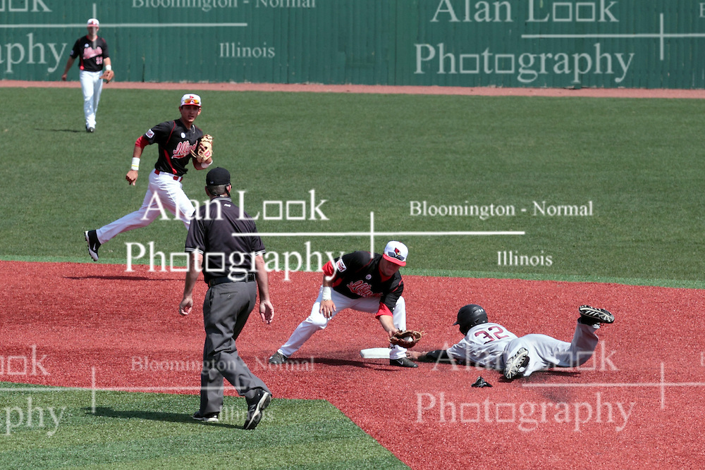 26 April 2014:   umpire Tim Catton watches second as Connor Kopach slides into second and gets a tag applied by Joe Kelch during an NCAA Division 1 Missouri Valley Conference (MVC) Baseball game between the Southern Illinois Salukis and the Illinois State Redbirds in Duffy Bass Field, Normal IL