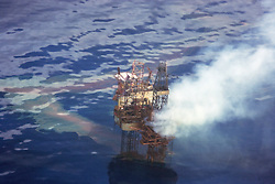 The Montara oil platform on fire two days after the accident in the Timor Sea.