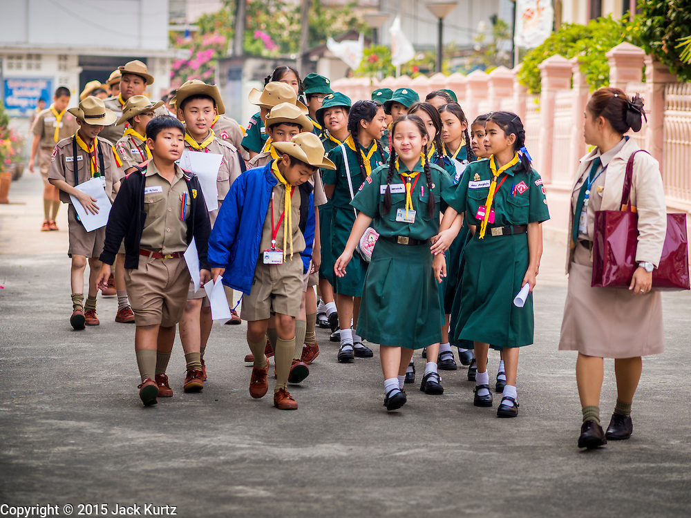 11 FEBRUARY 2015 - BANGKOK, THAILAND: Thai Boy and Girl Scouts walk through the plaza around the Santa Cruz Catholic church in Bangkok. The neighborhood around Santa Cruz Catholic church is known for the Thai adaptation of Portuguese cakes baked in the neighborhood. Several hundred Siamese (Thai) Buddhists converted to Catholicism in the 1770s. Some of the families started baking the cakes. When the Siamese Empire in Ayutthaya was sacked by the Burmese, the Portuguese and Thai Catholics fled to Thonburi, in what is now Bangkok. The Portuguese established a Catholic church near the new Siamese capital. There are still a large number of Thai Catholics living in the neighborhood around the church.     PHOTO BY JACK KURTZ