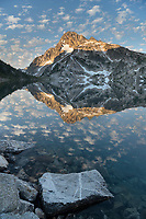 Mount Regan mirrored in still waters of Sawtooth Lake at sunrise. Sawtooth Mountains Wilderness Idaho