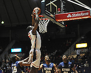 """Ole Miss' Reginald Buckner (23) dunks vs. East Tennessee State at the C.M. """"Tad"""" Smith Coliseum in Oxford, Miss. on Saturday, December 14, 2012. Mississippi won 77-55 to improve to 7-1. (AP Photo/Oxford Eagle, Bruce Newman).."""