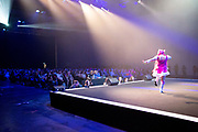 UNITED KINGDOM, London: 25 May 2019 <br /> A cosplay competitor parades on stage in front of hundreds of cosplay fans as she competes in the Championships of Cosplay during the MCM London Comic Con. The three day comic convention is being held at London ExCeL from Fri 24th - Sun 26th of May.