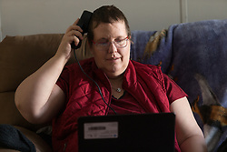 1/27/15 11:57:19 AM -- Louisa, KY, U.S.A  -- Cheryl Castle uses the remote monitor and wand to collect data from the neurostimulator. Castle is a recent recipient of the high-tech device, can now do many tasks she was unable to do when her epileptic seizures became more severe and more frequent. Now she's getting back to a normal life.<br /> <br />  --    Photo by Jonathan Palmer, Freelance