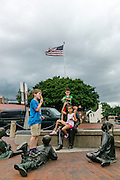 "Annapolis, Maryland - June 05, 2016: Siblings Maia, 8, and Adham Eissa, 9, right, eat ice cream with their friend Christopher, left, (parents don't want his last name published) atop the Kunta Kinte-Alex Haley Memorial statue in historic Annapolis Sunday June 5th, 2016. Earlier that day a perigean spring tide brought some of the highest water levels of the year to the coastal town and partially flooded the park. <br /> <br /> A perigean spring tide brings nuisance flooding to Annapolis, Md. These phenomena -- colloquially know as a ""King Tides"" -- happen three to four times a year and create the highest tides for coastal areas, except when storms aren't a factor. Annapolis is extremely susceptible to nuisance flooding anyway, but the amount of nuisance flooding has skyrocketed in the last ten years. Scientists point to climate change for this uptick. <br /> <br /> <br /> CREDIT: Matt Roth for The New York Times<br /> Assignment ID: 30191272A"