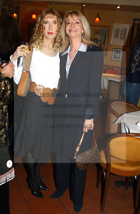 Left to right, BASHIA BRIGGS and CHARLY SPRY  at a pre-screening party of a film by Fiona Sanderson entitled 'The Hunt For Lord Lucan' held at Langans, 254 Old Brompton Road, London SW7 on 8th November 2004.<br />