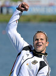 MAX HOFF (GERMANY) CELEBRATES HIS VICTORY IN MEN'S K1 1000 METERS FINAL A RACE DURING 2010 ICF KAYAK SPRINT WORLD CHAMPIONSHIPS ON MALTA LAKE IN POZNAN, POLAND...POLAND , POZNAN , AUGUST 21, 2010..( PHOTO BY ADAM NURKIEWICZ / MEDIASPORT ).