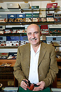 Portrait of a mature tobacco shop owner
