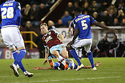 Kagisho Dikgacoi of Cardiff City  successfully makes a sliding tackle on Scott Arfield of Burnley Burnley and Cardiff City at Turf Moor, Burnley, England on 5 April 2016. Photo by Simon Brady.