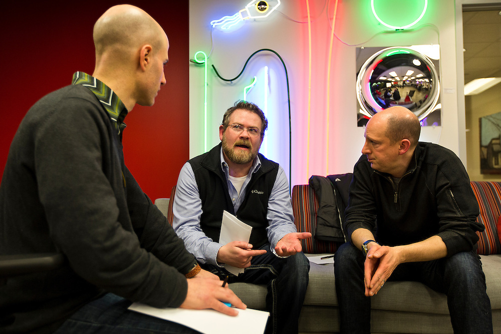 "Marketing consultant Matt Nelson, center, discusses ways to strengthen freelancer legislation during the 100state ""Problem Solving Soirée"" on January 11, 2017. The event kicked off the opening of the entrepreneurial coworking space on the 6th floor of 316 West Washington Avenue in Madison."