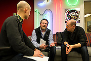 """Marketing consultant Matt Nelson, center, discusses ways to strengthen freelancer legislation during the 100state """"Problem Solving Soirée"""" on January 11, 2017. The event kicked off the opening of the entrepreneurial coworking space on the 6th floor of 316 West Washington Avenue in Madison."""