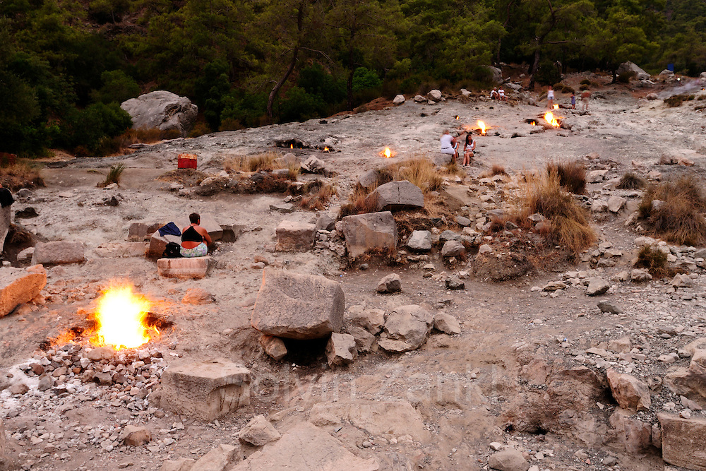 The Chimaera or Chimera near Cirali in Turkey are eternal flames that spontaneously burn on the slopes of a little mountain since ancient times. Gas is leaking from crevices in the rocks and nourishes the natural fires wich served as a landmark for ships in the old times.