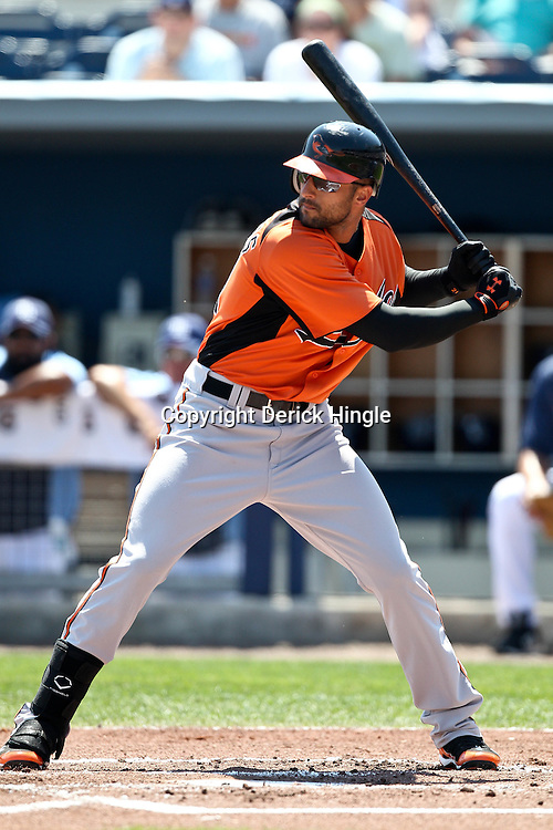 March 20, 2011; Port Charlotte, FL, USA; Baltimore Orioles right fielder Nick Markakis (21) during a spring training exhibition game against the Tampa Bay Rays at Charlotte Sports Park.   Mandatory Credit: Derick E. Hingle