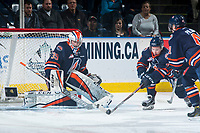 KELOWNA, CANADA - MARCH 25: Luke Zazula #7 clear the puck from in front of the net of Connor Ingram #39 of the Kamloops Blazers against the Kelowna Rockets on March 25, 2017 at Prospera Place in Kelowna, British Columbia, Canada.  (Photo by Marissa Baecker/Shoot the Breeze)  *** Local Caption ***