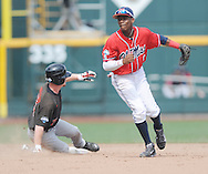 Mississippi's Errol Robinson (6) forces out Texas Tech's Bryant Burleson (21) and throws to first for a double play at T.D. Ameritrade Park in the College World Series in Omaha, Neb. on Tuesday, June 17, 2014. Ole Miss won 2-1.