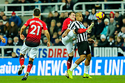 Phil Jones (#4) of Manchester United challenges Jose Salomon Rondon (#9) of Newcastle United during the Premier League match between Newcastle United and Manchester United at St. James's Park, Newcastle, England on 2 January 2019.