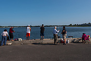 Belmar, NJ USA -- August 26, 2017 --Men, women, youth, seniors, hispanics and caucasians are fishing off a pier in Belmar. Editorial Use Only.