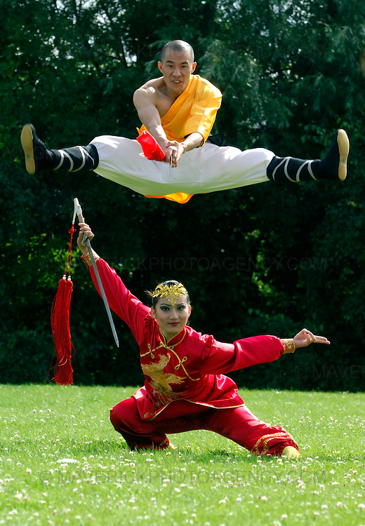 "EDINBURGH, UK - 4th August 2010: Chinese State Circus performers rehearse ahead of their opening night show ""Mulan"" on Friday 6th August at the Big Top at Ocean Terminal in Edinburgh...Picture shows a shaolin warrior jumping above the lead character ""Mulan""...(Photograph: Richard Scott/MAVERICK)"
