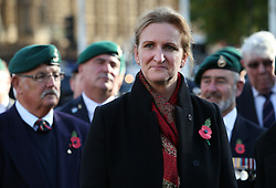 © Licensed to London News Pictures. 28/10/2015. London, UK. Claire Blackman (C) stands with veteran Royal Marines in Parliament Square during a rally calling for her husband, Sgt Alexander Blackman to be released.  Sgt Blackman was sentence for killing a Talliban insurgent in Afghanistan in 2011. He was convicted of murder at a court martial in 2013.   Photo credit: Peter Macdiarmid/LNP