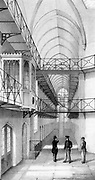 Reading Gaol, Berkshire, England. Opened 1844 and on the same plan as model the prison at Pentonville, arranged in 4 wings joined by central Inspection Hall. Approximately  520 cells, each with hammock, stool, table, gas light, wash basin and WC. Lithograph. Oscar Wilde imprisoned here after his disgrace.
