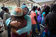 Elizabeth Ponder, center, hugs her daughter Exodus Ponder, left, while standing in line at the Savannah Civic Center before evacuating from he path of Hurricane Irma, Saturday, Sept., 9, 2017 in Savannah, Ga. (AP Photo/Stephen B. Morton)
