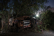 Car wrecks sit rotting away in Bangkok's 'car cemetery'. <br /> <br /> According to a 2014 study by the University of Michigan&rsquo;s Transportation Research Institute Thailand ranks number 2 in the world for road fatalities, narrowly second only to Namibia. The report found a frightening 44 road deaths were recorded per 10,000 population. The high accident rate is often attributed to reckless driving, including driving while intoxicated, and lack of safety precautions such as wearing a helmet on motorbikes. A WHO report indicated that 26 percent of road deaths in Thailand involve alcohol.<br /> <br /> The sheer number of crashed vehicles is so high that police now hold auctions to sell off the vehicles, either not wanted by their owner or beyond repair, and it has become a good business. But the auctions are a relatively new phenomenon where previously cars would be kept at police stations until the legal case is complete and then deposited at a collection site.<br /> <br /> On the outskirts of Bangkok in a scruffy suburb is one such depository. Dubbed &lsquo;the car cemetery&rsquo; by locals it was where many of Bangkok&rsquo;s damaged wrecks would end up if no-one else wanted to them. But the site has also taken on another reputation; that of being one of the most haunted places in the city, third to be precise according to a local TV station. Thai&rsquo;s are very superstitious people and most believe in ghosts or spirits. Here it was believed that the spirits of those killed in the crashes remained with the vehicles they died in. Many a passerby or taxi driver have stories of people in and around the compound who then simply vanishing. Locals became so frightened of the place that a group of Thai Buddhist monks from a nearby temple were invited in to perform a ritual exorcism to release the spirits.<br /> <br /> With most crashed cars now being bought at the auctions the car cemetery doesn&rsquo;t receive new vehicles anymore but many of the old ones remain surrounded by weeds and covered in rust. Grotesque relics and unwanted wre