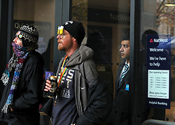© Licensed to London News Pictures. 24/11/2011, London, UK. A Natwest employee looks out of the closed branch at the protesters. Protesters with a megaphone cause the closure of a branch of Natwest near to the camp. Occupy UK protest camp at St Paul's Cathedral today 24 November 2011. Photo credit : Stephen Simpson/LNP
