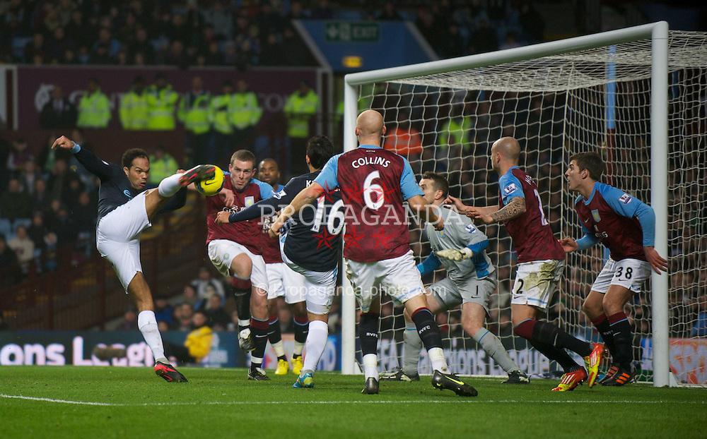 BIRMINGHAM, ENGLAND - Sunday, February 12, 2012: Manchester City's Joleon Lescott scores the first goal against Aston Villa during the Premiership match at Villa Park. (Pic by David Rawcliffe/Propaganda)