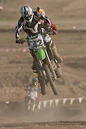Middletown, New York - Riders fly through the air on a jump at Orange County Fair Motocross practice on May 14, 2014.