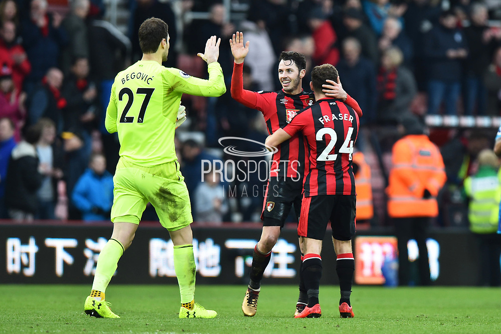 Asmir Begovic (27) of AFC Bournemouth, Adam Smith (15) of AFC Bournemouth and Ryan Fraser (24) of AFC Bournemouth celebrate the 2-1 win over Arsenal at full tim during the Premier League match between Bournemouth and Arsenal at the Vitality Stadium, Bournemouth, England on 14 January 2018. Photo by Graham Hunt.