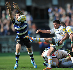 Jonny Arr (Worcester) box-kicks the ball clear as Matt Banahan (Bath) attempts to charge him down - Photo mandatory by-line: Patrick Khachfe/JMP - Tel: Mobile: 07966 386802 19/04/2014 - SPORT - RUGBY UNION - The Recreation Ground, Bath - Bath Rugby v Worcester Warriors - Aviva Premiership.