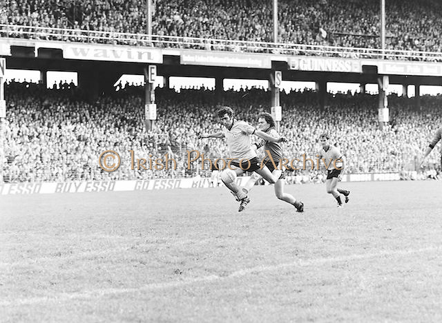 Kerry pushes Dublin as they run for the ball during the Kerry v Dublin All Ireland Senior Gaelic Football Final in Croke Park on the 24th of September 1978. Kerry 5-11 Dublin 0-9.