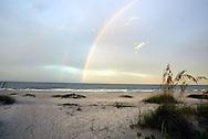 A double rainbow greets the sunrise on the beach on Sanibel Island, Florida