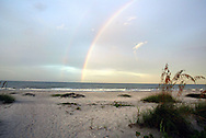 A double rainbow greets the sunrise on the beach on Sanibel Island, Florida