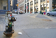 Hydrant on corner of Manhattan's street..