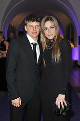 Footballer ANDREI ARSHAVIN and his wife YULIA at The Surrealist Ball in aid of the NSPCC in association with Harpers Bazaar magazine held at the Banqueting House, Whitehall, London on 17th March 2011.