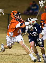 Virginia Cavaliers LSM Mike Timms (44) scores a goal past Mt. Saint Mary's D Brendan Flanagan (12).  The #2 ranked Virginia Cavaliers defeated the Mt. Saint Mary's Mount 10-2 at the University of Virginia's Klockner Stadium in Charlottesville, VA on February 24, 2009.   (Special to the Daily Progress / Jason O. Watson)