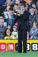 A local 14-year-old musician plays 'The Last Post' as part of the Remembrance Matchday arrangements to mark the 100th anniversary of the start of WWI before the Sky Bet Championship match at Vicarage Road, Watford<br /> Picture by David Horn/Focus Images Ltd +44 7545 970036<br /> 01/11/2014