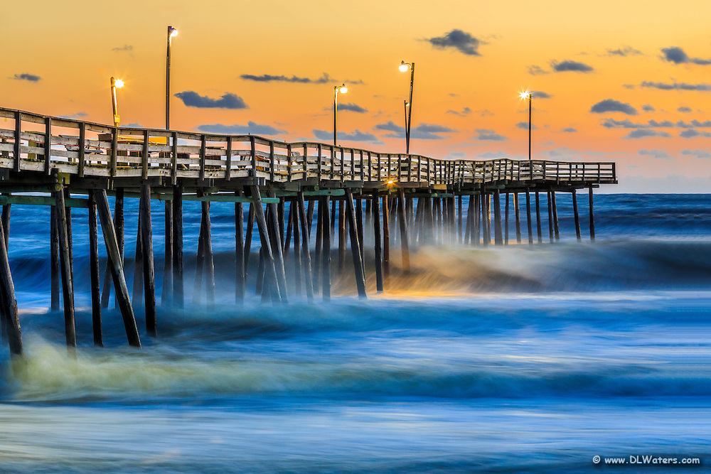 Sunrise with large surf at the Outer Banks Fishing Pier in South Nags Head.