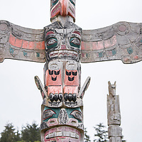 Totem poles at the 'Namgis burial grounds and cemetery in Alert Bay, Cormorant Island, British Columbia, Canada. Pole shown is Thunderbird, Sisiyut.