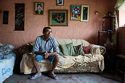 Manuel Parra in his home in Callao.