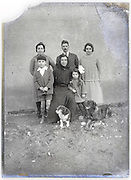 early 1900s portrait of grandmother with grandchildren and family plus dogs