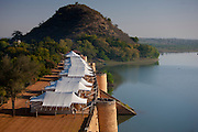 Chhatra Sagar reservoir and luxury tented camp oasis in the desert at Nimaj, Rajasthan, Northern India